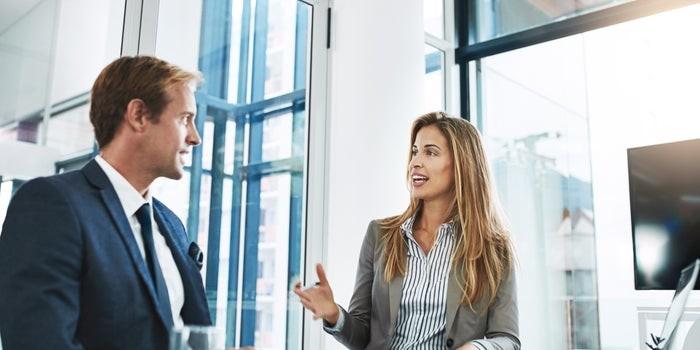Two leaders providing feedback