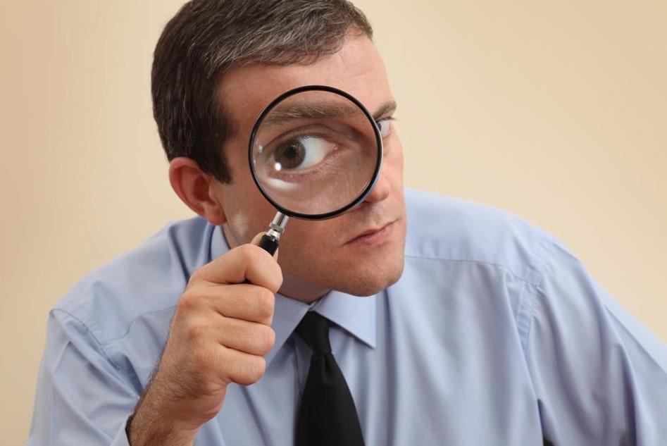 Executive examining themselves