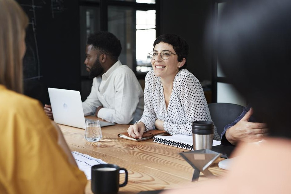Female leader smiling at meeting