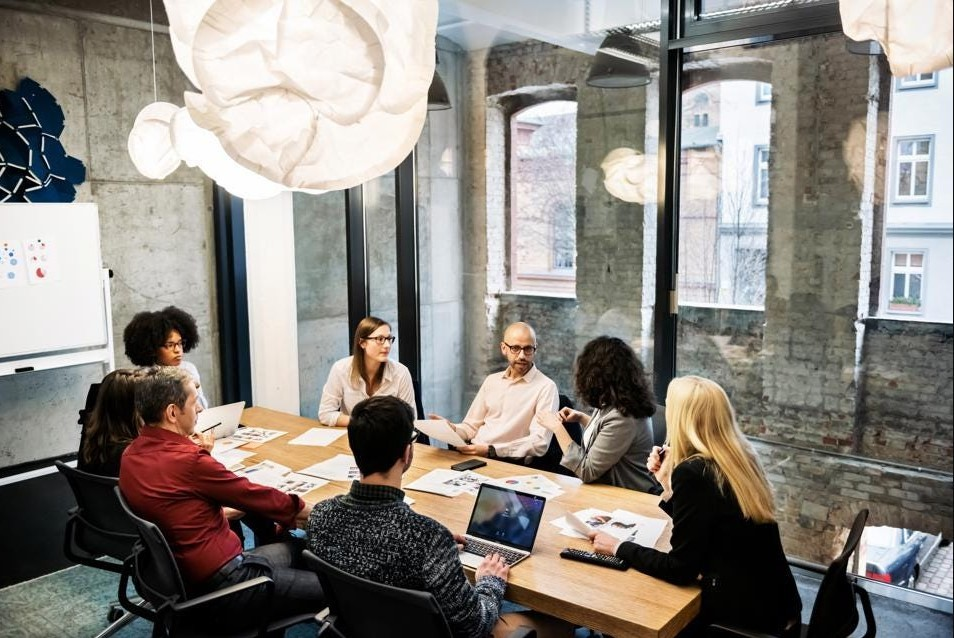 Young, diverse leaders in a team meeting